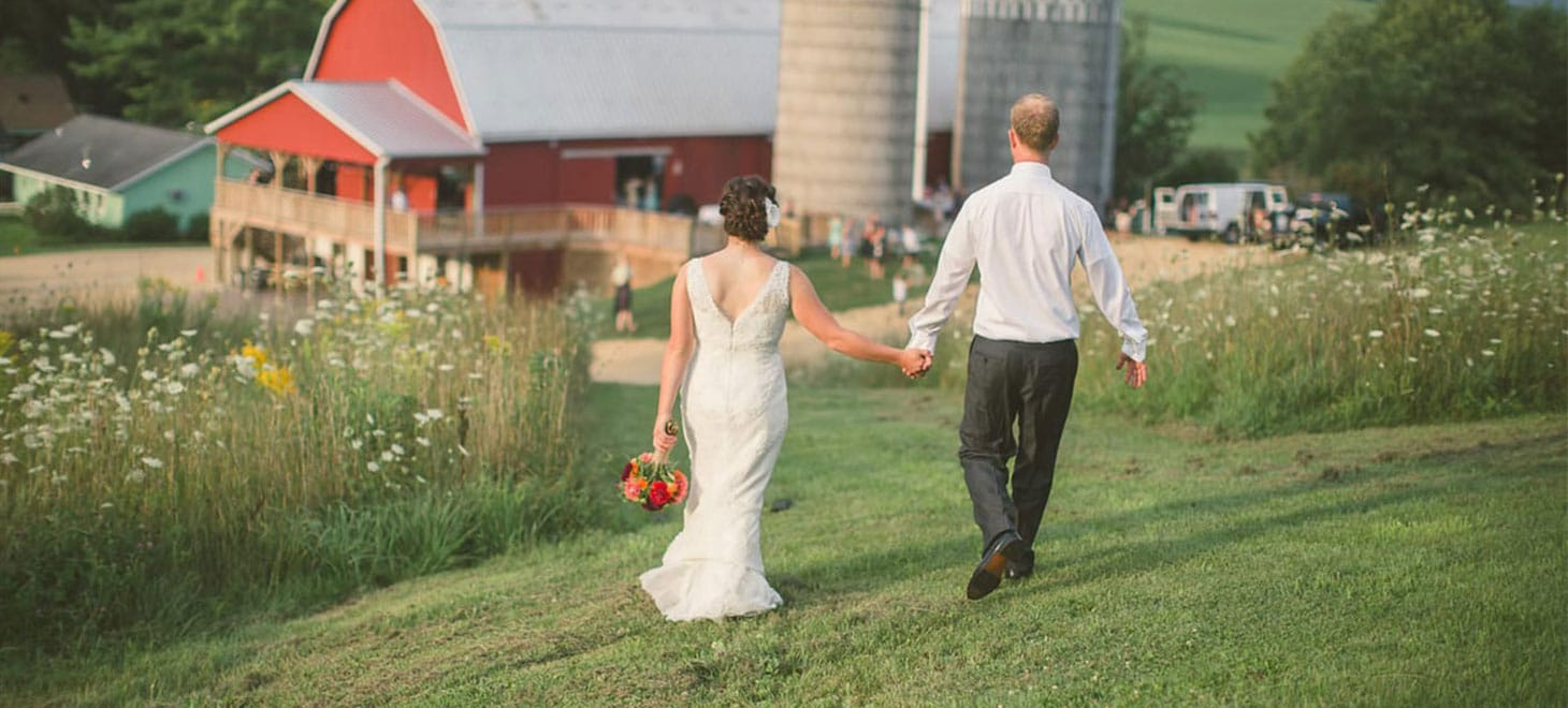 Wisconsin Barn Wedding Bride and Groom walking to barn