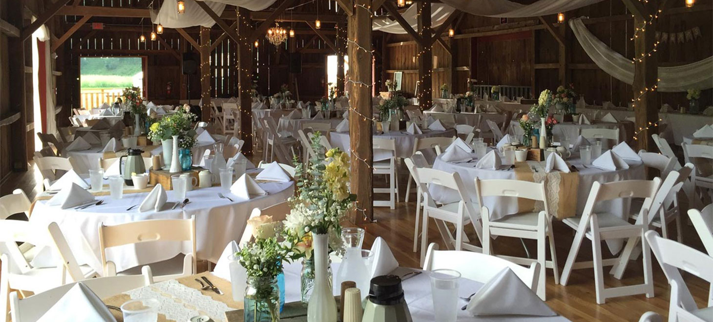 Decorated tables and chairs for a Wisconsin Barn Wedding at Justin Trails Resort, Sparta