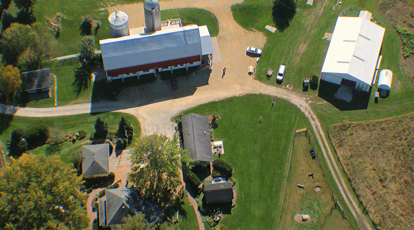 Best Wisconsin Vacations birds eye view of cabins, ,Elegant Barn, cottage, Lodge, llama pen Justin Trails Resort, Sparta