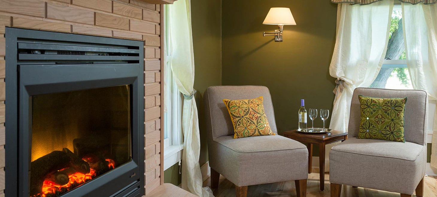 Enjoy a glass of wine by the fire in our romantic Queen Suite in Sparta, Wisconsin, Justin Trails Resort