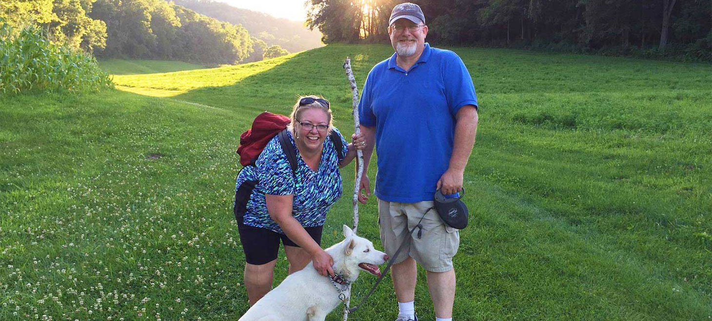 Couple with Heidi, our Siberian husky enjoying Pet Friendly Cabins in Wisconsin with dog trails, Justin Trails Resort, Sparta