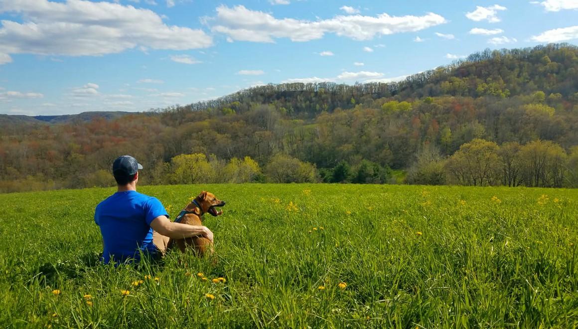 Man and dog enjoying scenic view at Justin Trails Resort
