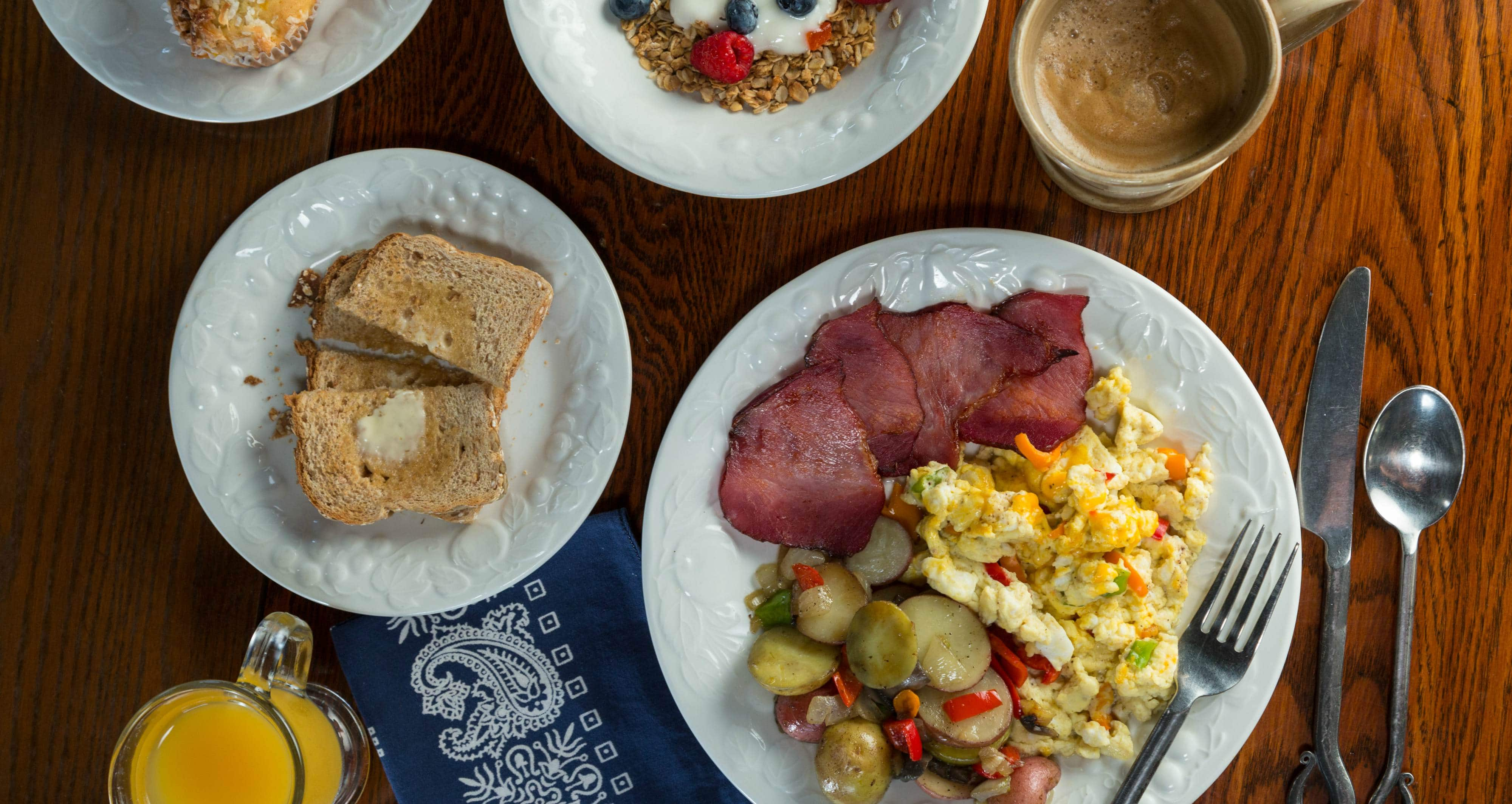 Wisconsin Bed and Breakfast Eggs, thick-cut bacon from the butcher, handmade granola, vegetables fresh fruit and egg dish
